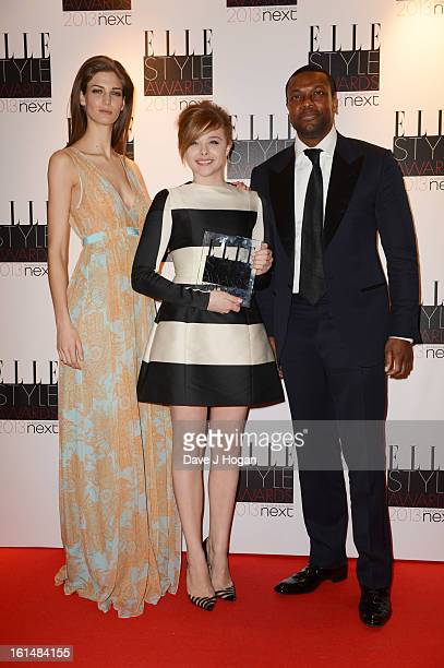 Chris Tucker and Kendra Spears pose with Chloe Moretz after presenting her with the Next Future Icon Award in the press room at The Elle Style Awards...