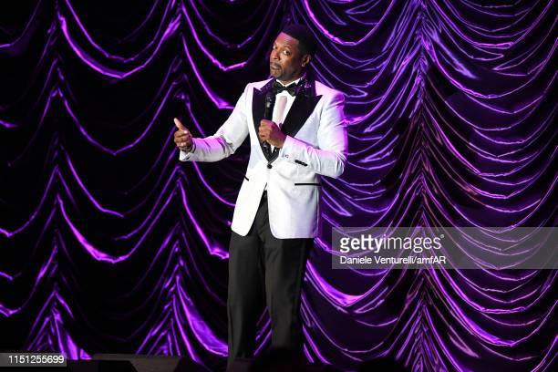 Chris Tucker performs on stage during the amfAR Cannes Gala 2019 at Hotel du CapEdenRoc on May 23 2019 in Cap d'Antibes France