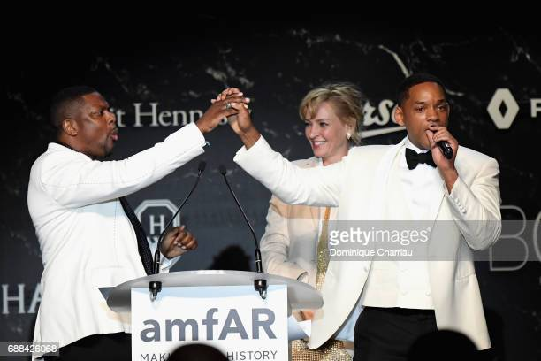 Chris Tucker Uma Thurman and Will Smith are seen on stage at the amfAR Gala Cannes 2017 at Hotel du CapEdenRoc on May 25 2017 in Cap d'Antibes France