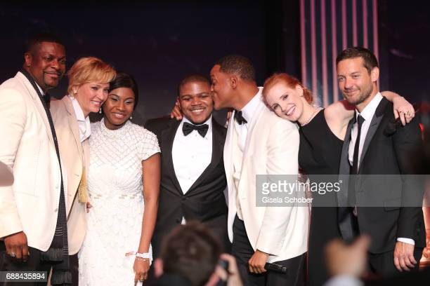 Chris Tucker Uma Thurman auction winners Will Smith Jessica Chastain and Tobey Maguire are seen on the stage at the amfAR Gala Cannes 2017 at Hotel...