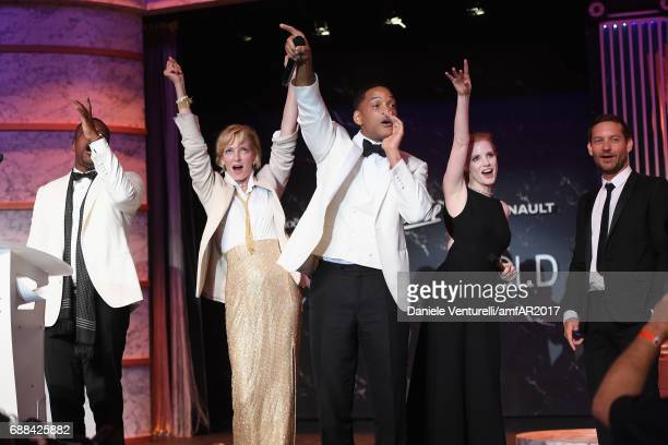 Chris Tucker Uma Thurman Will Smith Jessica Chastain and Tobey Maguire are seen on stage at the amfAR Gala Cannes 2017 at Hotel du CapEdenRoc on May...