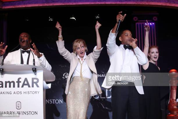 Chris Tucker Uma Thurman Will Smith Jessica Chastain and Tobey Maguire on stage at the amfAR Gala Cannes 2017 at Hotel du CapEdenRoc on May 25 2017...