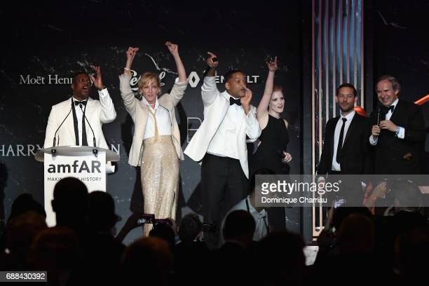 Chris Tucker Uma Thurman Will Smith Jessica Chastain Tobey Maguire and Simon de Pury are seen on stage at the amfAR Gala Cannes 2017 at Hotel du...