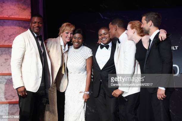 Chris Tucker Uma Thurman winners of the auction Willl Smith Jessica Chastain and Tobey Maguire on stage at the amfAR Gala Cannes 2017 at Hotel du...