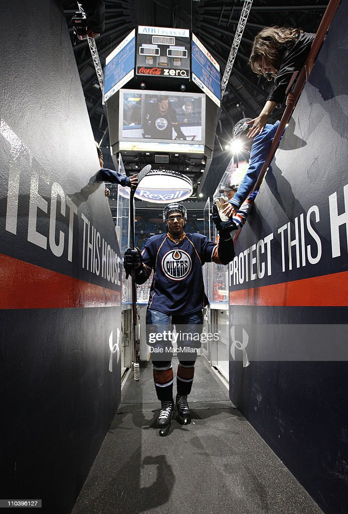 Chris Vande Velde #54 of the Edmonton Oilers high fives a fan following pre game warm up as he prepares to play the Phoenix Coyotes at Rexall Place March 17, 2011 in Edmonton, Alberta, Canada.