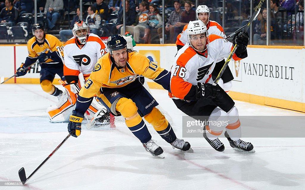 Chris Vande Velde #76 of the Philadelphia Flyers skates against Olli Jokinen #13 of the Nashville Predators at Bridgestone Arena on December 27, 2014 in Nashville, Tennessee.