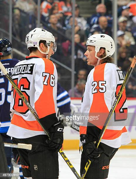 Chris VandeVelde and Ryan White of the Philadelphia Flyers discuss strategy during a third period stoppage in play against the Winnipeg Jets at the...