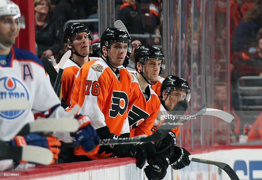 Chris VandeVelde #76, Dale Weise #22 and Taylor Leier #58 of the Philadelphia Flyers react to the play on the ice against the Edmonton Oilers on December 8, 2016 at the Wells Fargo Center in Philadelphia, Pennsylvania.