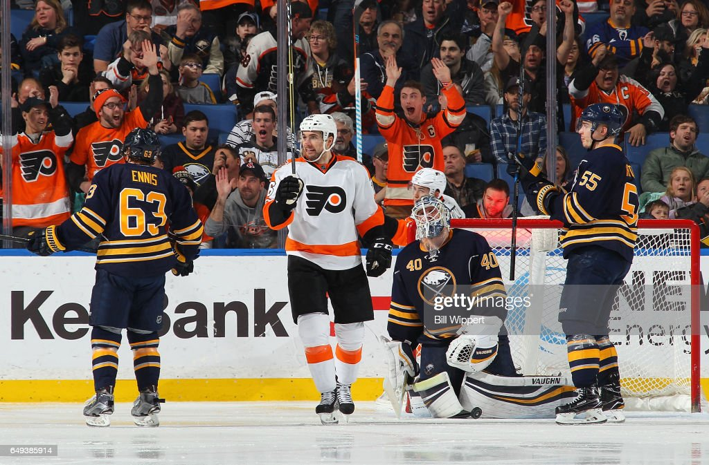 Chris VandeVelde #76 of the Philadelphia Flyers celebrates a third period goal by Travis Konecny (not shown) alongside Robin Lehner #40 and Rasmus Ristolainen #55 of the Sabres during an NHL game at the KeyBank Center on March 7, 2017 in Buffalo, New York. The Flyers won, 6-3.