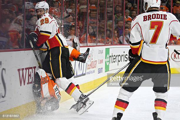 Chris VandeVelde of the Philadelphia Flyers is checked by Deryk Engelland of the Calgary Flames during the second period at Wells Fargo Center on...