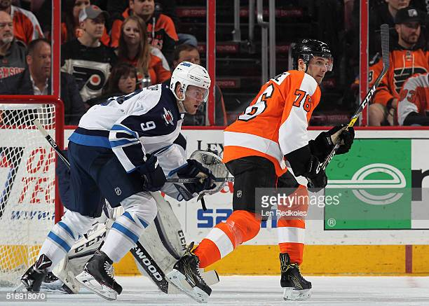 Chris VandeVelde of the Philadelphia Flyers skates against Andrew Copp of the Winnipeg Jets on March 28 2016 at the Wells Fargo Center in...