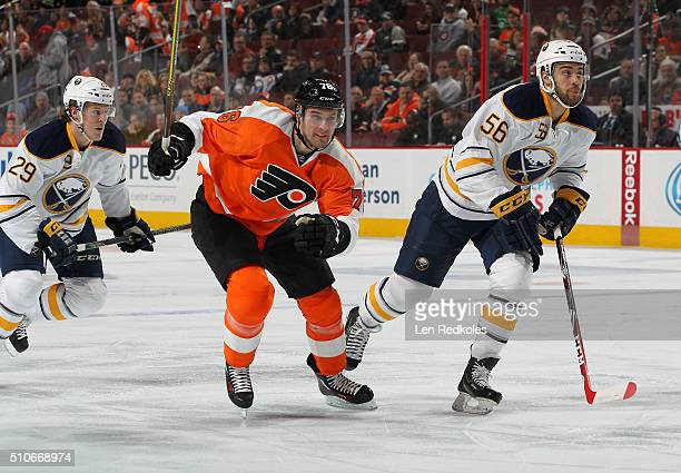 Chris VandeVelde of the Philadelphia Flyers skates against Justin Bailey and Jake McCabe of the Buffalo Sabres on February 11, 2016 at the Wells...