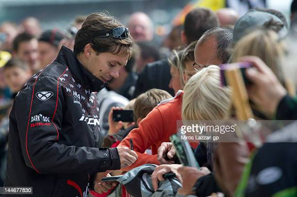 Chris Vermeulen of Australia and NGM Mobile Forward Racing signs autographs for fans during the MotoGp Of France on May 17 2012 in Le Mans France