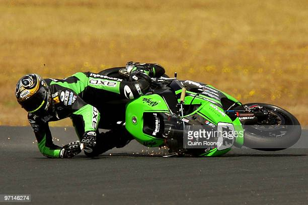 Chris Vermeulen of Australia and the Kawasaki Racing Team crashes during the Superbike World Championship round one race one at Phillip Island Grand...