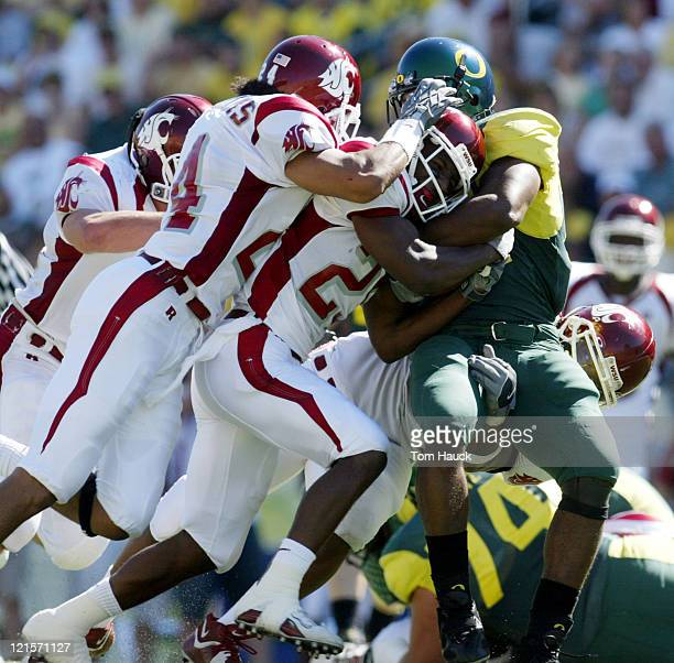 Chris Vincent of the Oregon Ducks is stopped by the of the Washington State Cougars defense at Autzen Stadium in Eugene Oregon Oregon lost to...