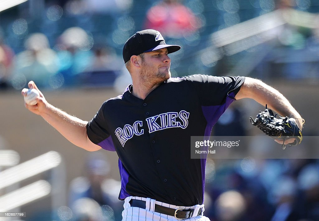 Chris Volstad #31 of the Colorado Rockies delivers a pitch against the Texas Rangers at Salt River Field on February 25, 2013 in Scottsdale, Arizona.
