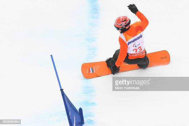 Chris Vos of the Netherlands competes in the Snowboard Men's Banked Slalom SBLL1 Run 2 on day seven of the PyeongChang 2018 Paralympic Games on March...