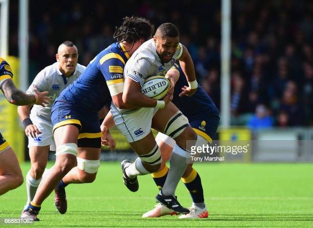 Chris Vui of Worcester Warriors tackles Taulupe Faletau of Bath Rugby during the Aviva Premiership match between Worcester Warriors and Bath Rugby at...
