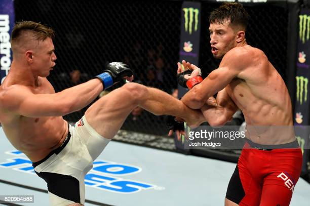 Chris Wade kicks Frankie Perez in their lightweight bout during the UFC Fight Night event inside the Nassau Veterans Memorial Coliseum on July 22...