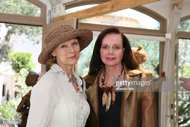 Chris Wagner and Geraldine Clark attend the Trigg Ison Fine art exhibit for the work of Maxine Kim StussyFrankel at her home June 28 2008 in Los...
