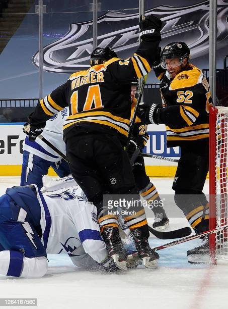 Chris Wagner and Sean Kuraly of the Boston Bruins react after Wagner scored in the third period of a Round Robin game against the Tampa Bay Lightning...