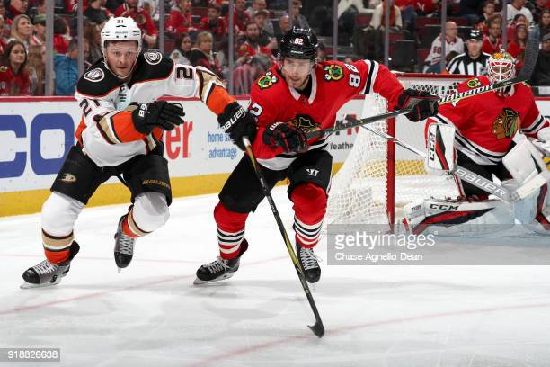 Chris Wagner of the Anaheim Ducks and Jordan Oesterle of the Chicago Blackhawks skate in the third period at the United Center on February 15 2018 in...