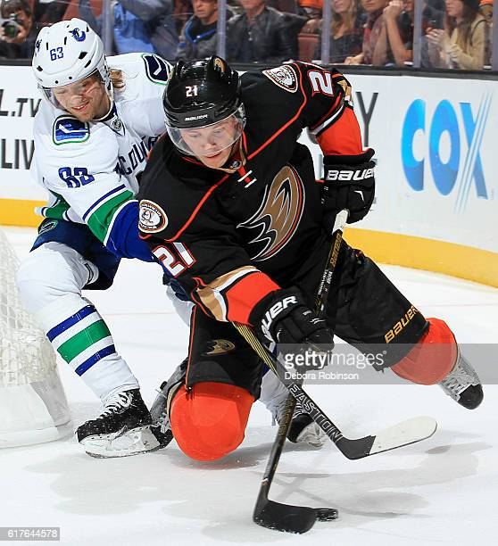 Chris Wagner of the Anaheim Ducks battles for the puck against Philip Larsen of the Vancouver Canucks on October 23 2016 at Honda Center in Anaheim...