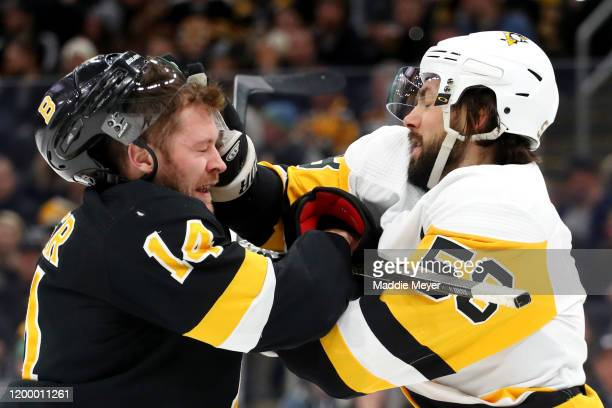 Chris Wagner of the Boston Bruins and Kris Letang of the Pittsburgh Penguins fight during the first period at TD Garden on January 16, 2020 in...
