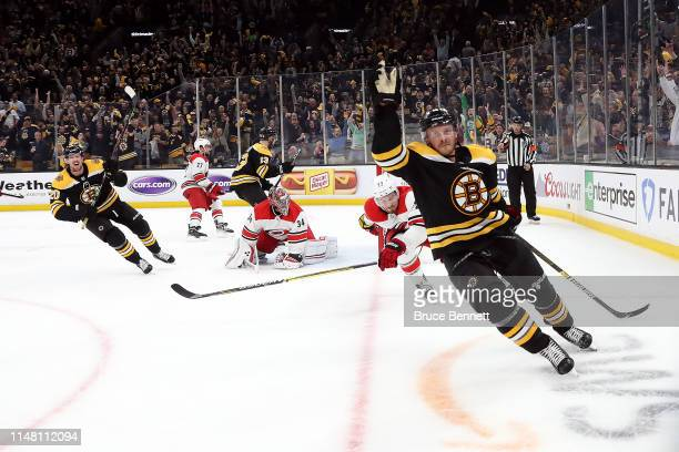 Chris Wagner of the Boston Bruins celebrates after scoring a third period goal against Petr Mrazek of the Carolina Hurricanes in Game One of the...