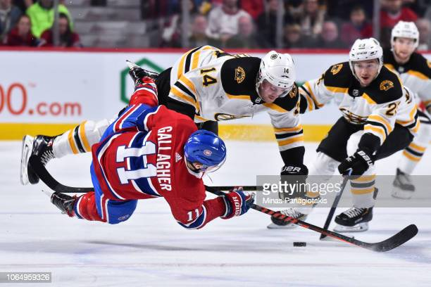 Chris Wagner of the Boston Bruins collides with Brendan Gallagher of the Montreal Canadiens during the NHL game at the Bell Centre on November 24...