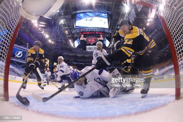 Chris Wagner of the Boston Bruins plays the puck on his back hand and shoots it into the net for a goal in the third period of a Round Robin game...