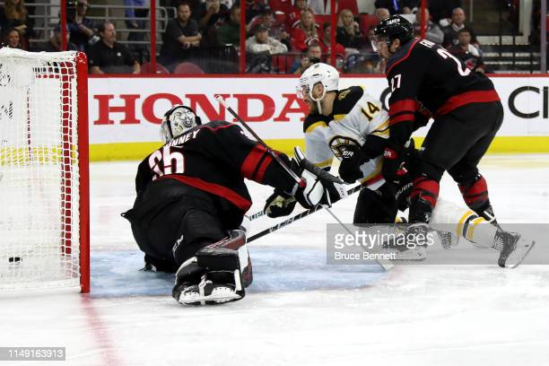 Chris Wagner of the Boston Bruins scores a goal on Curtis McElhinney of the Carolina Hurricanes during the second period in Game Three of the Eastern...