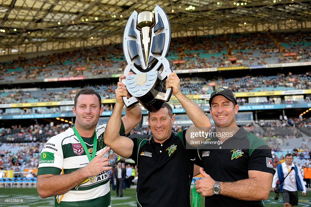 Chris Walker, Ben Walker, Shane Walker of the Jets hold aloft the winners trophy after the 2015 State Championship Grand Final match between Ipswich Jets and the Newcastle Knights at ANZ Stadium on October 4, 2015 in Sydney, Australia.