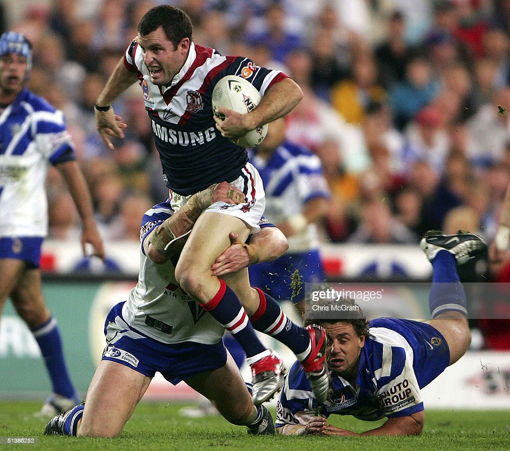Chris Walker of the Roosters makes a break during the NRL Grand Final between the Sydney Roosters and the Bulldogs held at Telstra Stadium, October 3, 2004 in Sydney, Australia.