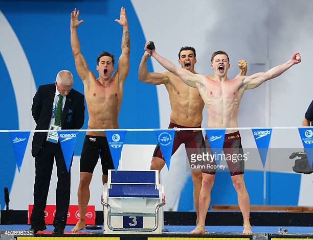 Chris Walker-Hebborn, Adam Barrett and Adam Peaty of England celebrate winning the gold medal in the Men's 4 x 100m Medley Relay Final at Tollcross...