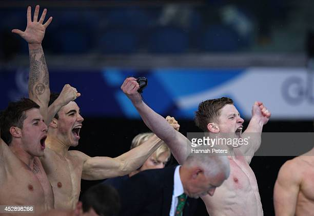 Chris WalkerHebborn Adam Barrett and Adam Peaty of England celebrate winning the gold medal in the Men's 4 x 100m Medley Relay Final at Tollcross...