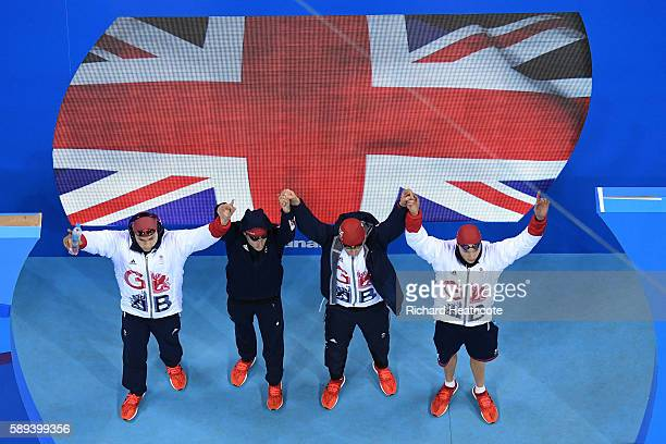 Chris WalkerHebborn Adam Peaty James Guy and Duncan Scott of Great Britain are greeted to the crowd before the Men's 4 x 100m Medley Relay Final on...