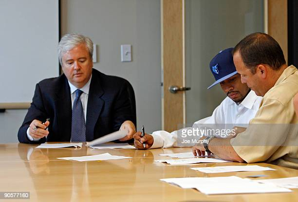 Chris Wallace General Manager of the Memphis Grizzlies Allen Iverson of the Memphis Grizzlies and Leon Rose agent of Allen Iverson sign his contract...
