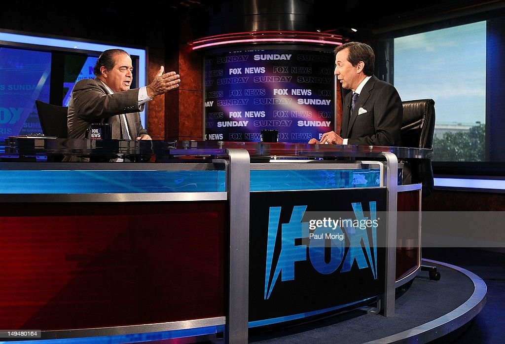 Chris Wallace (R) interviews U.S. Supreme Court Justice Antonin Scalia on 'FOX News Sunday' at the FOX News D.C. Bureau on July 27, 2012 in Washington, DC.
