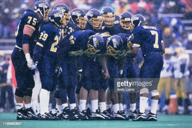 Chris Wallace, Quarterback for the University of Toledo Rockets gets into the huddle with his offensive line during the NCAA Mid-American Conference...