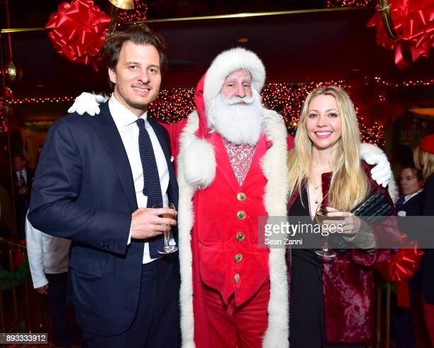 Chris Wallace Santa Claus and Emily Jerome attend A Christmas Cheer Holiday Party 2017 Hosted by George Farias and Anne and Jay McInerney at The...