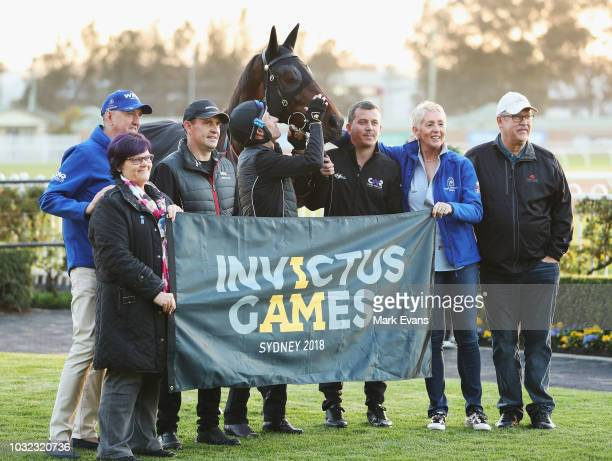 Chris Waller and Hugh Bowman with owners of Winx pose for a photo promoting the upcoming Invictus Games after a trackwork session at Rosehill Gardens...