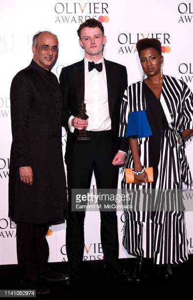 Chris Walley with the award for best actor in a supporting role with presenters Art Malik and Jade Anouka during The Olivier Awards with Mastercard...