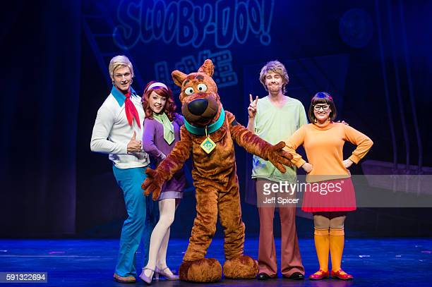 Chris Warner Drake as Fred Charlie Bull as Daphne Joe Goldie as ScoobyDoo Charlie Haskins as Shaggy and Rebecca Withers as Velma appear on stage in...