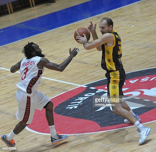 Chris Warren of Usak Sportif vies with Rolandas Alijevas of BC Siauliai during FIBA EuroChallenge Group H basketball match between Usak Sportif and...