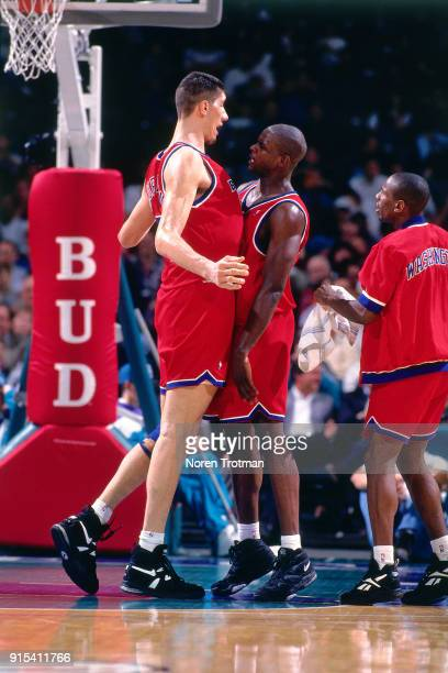 Chris Webber and Gheorghe Muresan of the Washington Bullets react during a game played on March 13 1995 at the Charlotte Coliseum in Charlotte North...