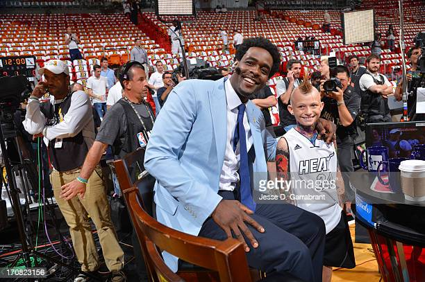 Chris Webber of NBATV greets a fan before the game of the Miami Heat against the San Antonio Spurs during Game Six of the 2013 NBA Finals on June 18...