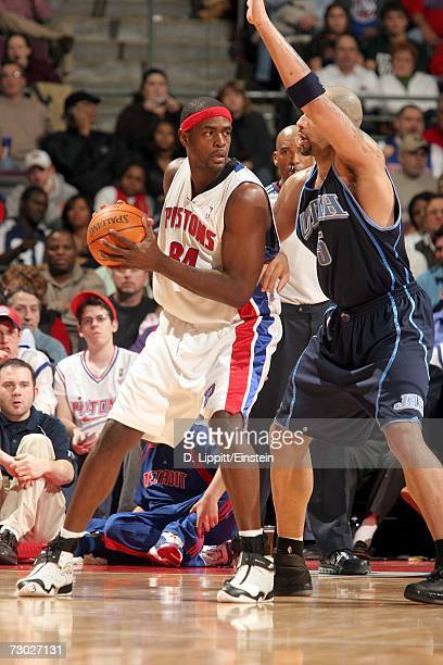 Chris Webber of the Detroit Pistons backs down against Carlos Boozer of the Utah Jazz on January 17 2007 at the Palace of Auburn Hills in Auburn...
