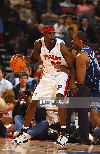 Chris Webber of the Detroit Pistons drives around CJ Miles of the Utah Jazz on January 17 2007 at the Palace of Auburn Hills in Auburn Hills Michigan...