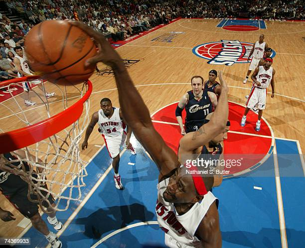 Chris Webber of the Detroit Pistons dunks against Drew Gooden of the Cleveland Cavaliers in Game Five of the Eastern Conference Finals during the...